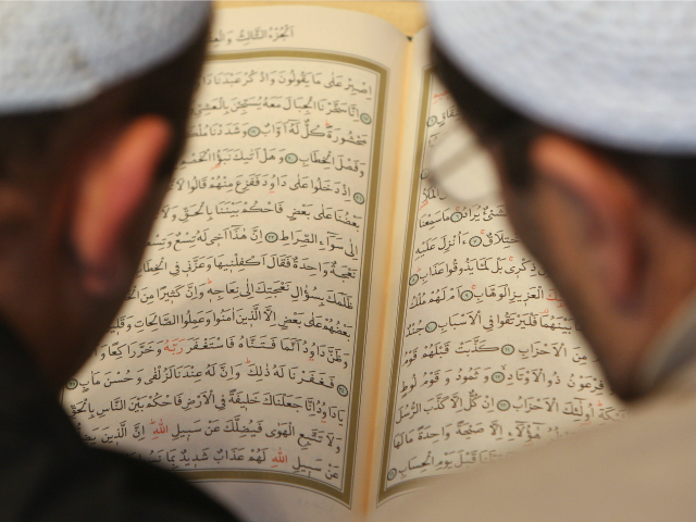 Muslim-men-study-the-Koran-at-the-Sehitlik-Mosque-on-open-house-day-at-German-mosques-Getty-640x480